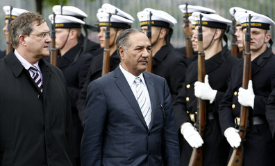 Pakistani Defence Minister Chaudhry Ahmed Mukhtar and his German counterpart Jung review a German Bundeswehr armed forces guard of honour following his arrival in Berlin