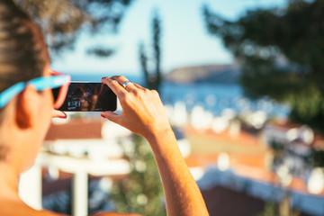 Female taking photo of city
