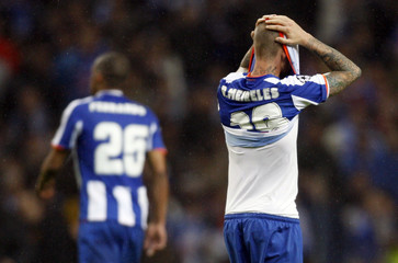 Porto players react after losing their Champions League quarter-final, second leg soccer match against Manchester United at Dragon stadium in Porto
