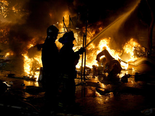 Firefighters hose down flames as the city of Valencia celebrates the final of its 'Fallas' festival ..