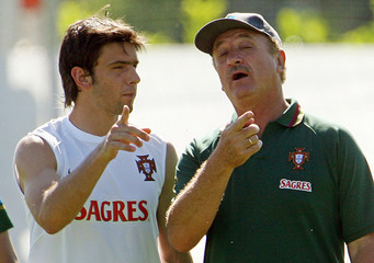 Portugal's coach Scolari talks with Postiga during World Cup soccer training session in Marienfeld