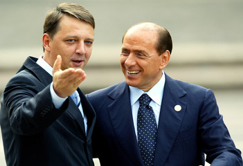 Italian PM Berlusconi and Slovenian PM Rop gesture as they arrive at the Campidoglio in Rome.