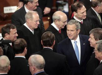 US President Bush shakes hands with House Minority Leader Boehner in Washington