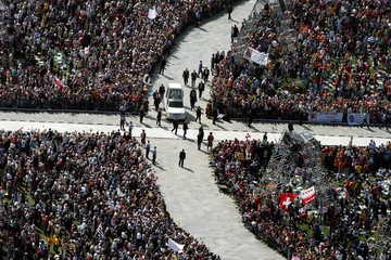 Aerial view of Pope John Paul II as he arrives on his popemobile to celebrate mass on the Allmend pa..