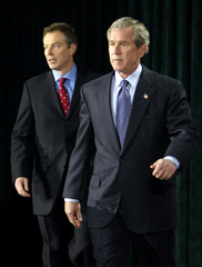 PRESIDENT BUSH AND PRIME MINISTER BLAIR ARRIVE FOR PRESS CONFERENCE.