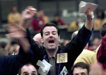 TRADER FRANTICALY SIGNALS IN NASDAQ PIT AT CHICAGO MERCANTILE EXCHANGE.