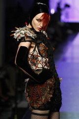 A model presents a creation by French designer Jean-Paul Gaultier as part of his Autumn/Winter 2009-2010 Haute Couture fashion show in Paris