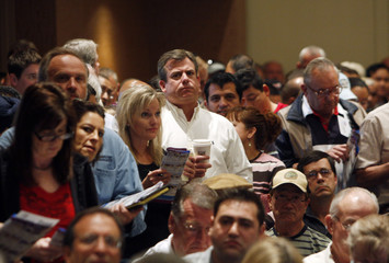 People attend the Zetabid foreclosed home auction at the Arizona Biltmore Resort and Spa in Phoenix