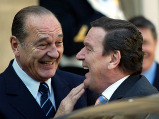 FRENCH PRESIDENT JACQUES CHIRAC GREETS GERMAN CHANCELLOR GERHARD SCHROEDER IN PARIS.