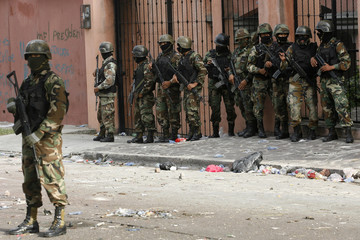 Soldiers stand guard after the dispersal of supporters of ousted Honduras President Manuel Zelaya, outside the Brazilian embassy in Tegucigalpa