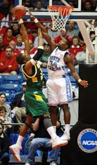 University of North Carolina's Noel blocks George Mason University's Thomas during NCAA game in Dayton