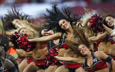 Tampa Bay Buccaneers cheerleaders perform before the start of the NFL football game between the Tampa Bay Buccaneers and New England Patriots at Wembley Stadium in London