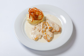 Chicken breast with mashed potato, onion and gravy