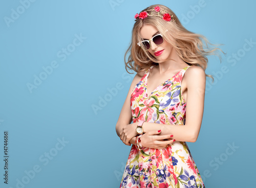 db1a26460 Fashion Beauty. Sensual Sexy Blond Model in fashion pose Smiling. Woman in Summer  Outfit. Trendy Floral Dress