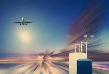 Traveler suitcases and airplane