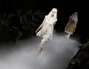 A model presents a creation by Japanese designer Tashiro at a fashion show during Japan Fashion Week in Tokyo