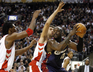 Raptors forwards Bosh and Bargnani guard Cavaliers O'Neal during their NBA basketball game in Toronto