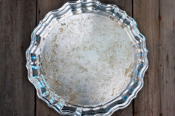 Metal old round tray with wavy edges, top view, horizontal
