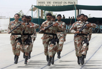 A contingent of Pakistan Ranger's anti terrorist Force march during their passing out in Karachi