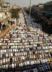 Muslims pray on a street outside a mosque in old Delhi.