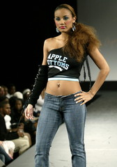 A model poses on the runway during a presentation for Apple Bottoms clothing, created by rapper Nell..