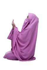 Side view of asian muslim woman wearing hijab praying