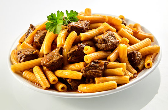 Tasty beef rigatoni Italian noodles with parsley