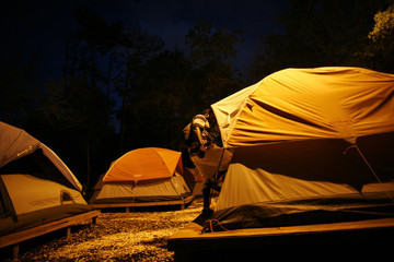 Mark Graham enters his tent at the tent city homeless community, knows as Pinellas Hope in Pinellas Park, Florida