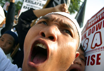 Indonesian Muslim man shouts during rally in front of US embassy in Jakarta