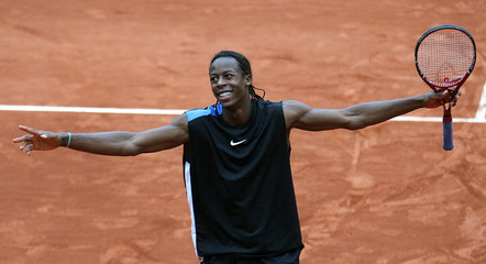 France's Monfils reacts during his match against Belgium's Norman during French Open tennis tournament in Paris