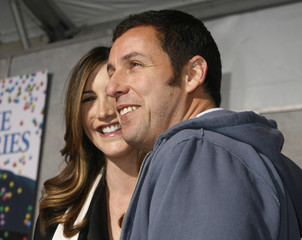 """Adam Sandler and wife at the premiere of the film """"Bedtime Stories"""" in Hollywood"""