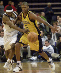 WIZARDS LARON PROFIT STEALS BALL FROM PACERS JALEN ROSE.