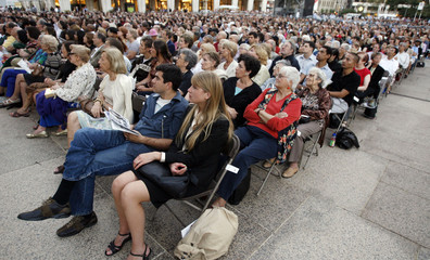 """Opera fans watch the opening night performance of """"Lucia di Lammermoor"""" during a simulcast in front of the Metropolitan Opera House in New York"""