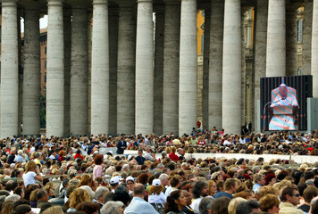 Pope John Paul II is seen on a large television screen in a packed Saint Peter's Square during his w..