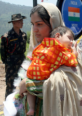 Pakistani woman enters India after boarding a new bus service between the two countries at Chakka Da Bagh in Poonch