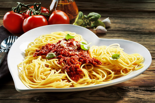 Heart-shaped bowl of spaghetti Bolognaise