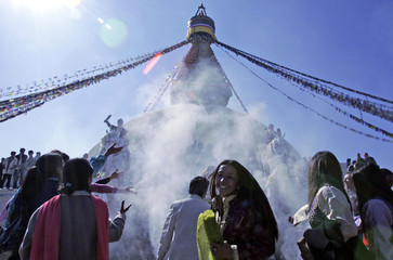 Tibetans attend their New Year celebrations at a monastery in Kathmandu