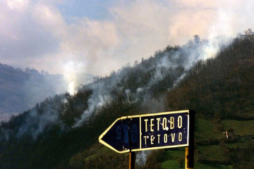 Smoke rises from the mountains in which ethnic Albanian guerrillas operate near the town of Tetovo, ..