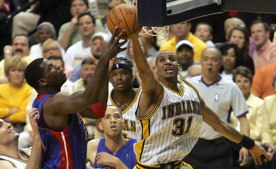 Indiana Pacers Miller puts up a shot over Pistons McDyess during Game 4.