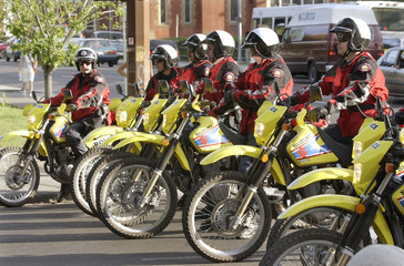 CALGARY CITY POLICE SIT ON DIRT BIKES AT PROTEST.