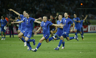 Italy players celebrate after defeating France in their World Cup 2006 final soccer match in Berlin