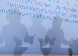 German Labour Minister von der Leyen casts a shadow as she addresses the media in Berlin