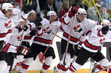 CANADIAN PLAYERS RUN ON ICE TO CELEBRATE VICTORY OVER SWEDEN AT THE ICEHOCKEY WORLD CHAMPIONSHIP ...