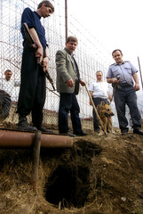 GEORGIAN POLICE OFFICIALS INVESTIGATE TUNNEL FROM PRISON IN TBILISI.