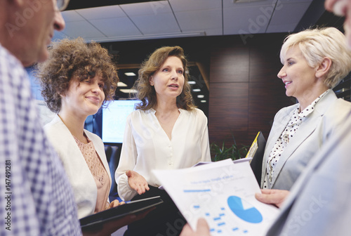 Business People Working Together In Office Stock Photo And