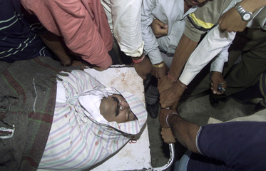 DEAD BODY OF A FORMER STATE GOVERNMENT MINISTER LIES ON A STRETCHER INAHMEDABAD.