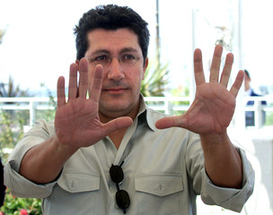 """French actor Alain Chabat gestures with both hands during a photo call for the animated film """"Shrek"""".."""