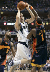 Dallas Mavericks' Nowitzki goes to the hoop against Golden State Warriors' Jackson in Game 5 of their NBA Western Conference quarterfinal in Dallas