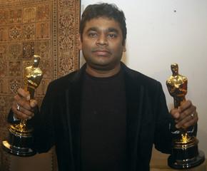 Music director Rahman holds his two Oscar award trophies in Chennai