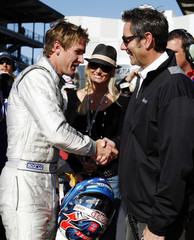 Ryan Hunter-Reay shakes hands with Tony George after qualifying at the Indianapolis Motor Speedway